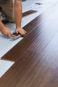 Garry Joy installing high quality dark wood laminate flooring showing prepared bases